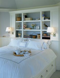 Built in shelving and lamps attached for alternative to side table and head board.