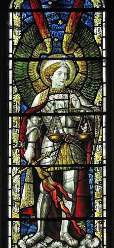 St Michael is here depicted as one who holds the scales of justice/ righteousness.