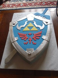 Legend of Zelda Hylian Shield cake created by: Cakes by Mom and Me, LLC
