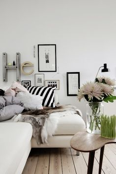 white sectional with throws