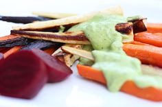 Green cashew sauce and roasted root vegetables.