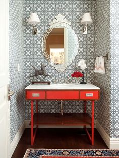 venetian mirror + geometric wallpaper + mod wood & red vanity