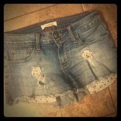 Distressed Denim Cutoffs WKND HOST PICK Very cute distressed denim with flower pocket.  Soft stretchy denim. Fits like a size 3 (juniors) 2.1 Denim Shorts Jean Shorts