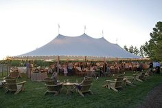 beautiful tent wedding with adirondack chairs