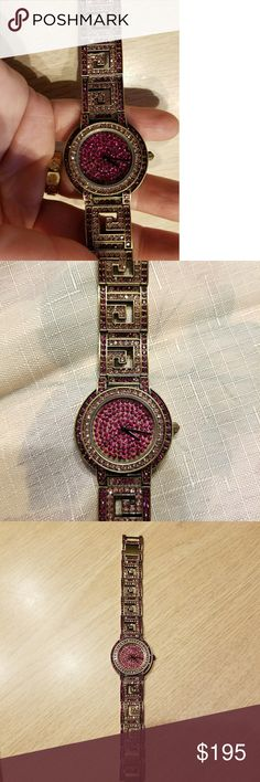 """Heidi Daus ladies watch Beautiful burgundy and pink crystal encrusted ladies link style watch. Antique gold finish,  Greek key design. Fits 7-8"""", easily removable clasp links adjust size. Brand new, never worn. Still has protective film on face and back.  No box Heidi Daus Jewelry"""