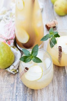 Spiced Pear & Ginger Pitcher - Grey Goose La Poire Vodka, Domaine de Canton Ginger Liqueur, Lemon Juice, Pear Juice, Cinnamon-Honey Syrup (Recipe), Vanilla Extract, Soda Water, Dry Sparkling Wine, Pears, Cinnamon Sticks, and Mint for Garnish.