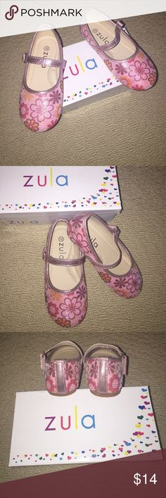 ⬇️SALE⬇️Zula pink floral Mary Janes 12 NWT Pink sparkly floral Mary Janes with Velcro closure in girls size 12. New in box. Super cute floral pattern with purple, yellow, and dark pink flowers. zula Shoes