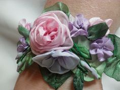 Ribbon work bracelet - would be a cool idea for prom or mother's wrist flowers at a wedding - no wilting :) Ribbon Art, Fabric Ribbon, Ribbon Crafts, Flower Crafts, Fabric Crafts, Sewing Crafts, Ribbon Flower, Wrist Flowers, Diy Flowers