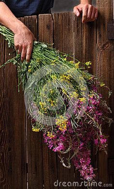 Man holding a huge bouquet of wildflowers