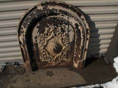 """ANTIQUE CAST IRON VICTORIAN FIREPLACE SURROUND WITH SUMMER COVER / INSERT. MADE BY T BENT & SONS NY ( NEW YORK CITY ) INSERT IS MARKED NO. 7 AND SURROUND IS MARKED 98. LOTS OF FLAKY PAINT. FIREPLACE ARCH IS 30 1/2"""" WIDE X 33"""" TALL AT THE CENTER. EACH LEGS IS 6 AND 9/16"""" WIDE INNER ARCH IS 26 3/4"""" TALL INSIDE ARCH. INSERT SUMMER COVER IS 17 5/8"""" WIDE X 27"""" TALL."""