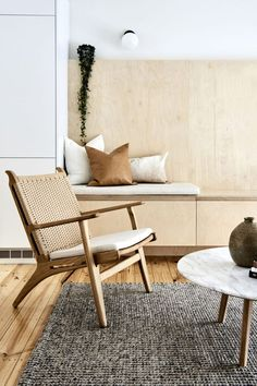 Highett House — Bicker. Cool interiors in this modern scandinavian setting. Lovely woodenarmchair