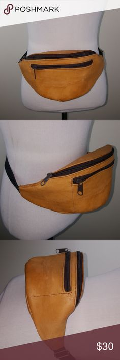 Vintage unisex folk leather tan boho fanny pack Tan leather festival boho vintage fanny pack with 2 compartments with brown zippers. Measurements: ( side to side leather body fanny pack only ) is 15.5 inches )   Adjustable to 39.5 to 46.5 inches Vintage Bags