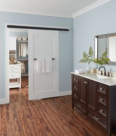 The track of the Johnson Wall Mount (Barn Door) Hardware Series 2610FB is easy to install and supports doors up to 200 pounds. Bronze Fascia is included.