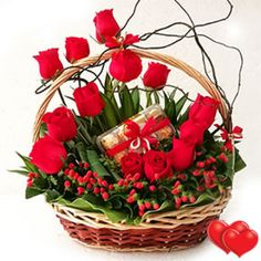A Basket Arrangement of Red #Roses with some fillers,greenery  a box of T16 Ferrero Rocher.