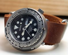 I added a to my collection recently. I normally buy automatic watches but the Seiko Tuna Cans are very hard to resist. One thing about quartz watches is that they are very convenient to use… Seiko Skx, Seiko Watches, Mens Sport Watches, Watches For Men, Wrist Watches, Field Watches, Popular Watches, Dream Watches, Men Necklace