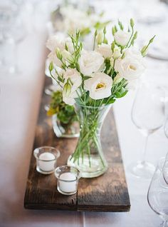 Add a few flowers from the garden and candles in glass containers (Source - http://laurenk.co.za)