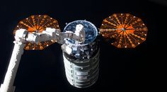 An Orbital ATK Cygnus cargo spacecraft arrives at the International Space Station in October. After departing the ISS, the Cygnus raised its orbit and deployed four Spire cubesats Nov. 25. Credit: NASA