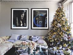 Opulent best sums up this modern living room. This is the home of florist Nikki Tibbles (Wild At Heart). The large flower decorations on the Christmas tree are extremely striking and bring a softness to the gold colour palette. Image: Livingetc.