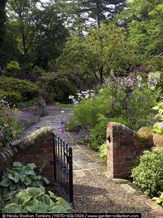 Garden gate and pathway! - hey maybe we could make a SHORT rock wall going across the side - could join things together, and make the trellis come out at the front corner of the garden instead of the corner of the house? Garden Gates And Fencing, Garden Path, Landscape Design, Garden Design, Garden Structures, Garden Spaces, Dream Garden, Garden Inspiration, Beautiful Gardens