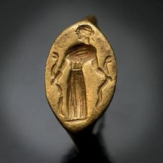 An incredible piece from our collection of early jewelry: a very rare ancient Greek gold signet ring engraved with an image of the Snake Goddess. Completely original, intact, and wearable. Circa 400 B.C.