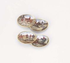 A PAIR OF ANTIQUE ENAMEL CUFF LINKS  Each link with enamelled hunting scene, circa 1900, in blue fitted case