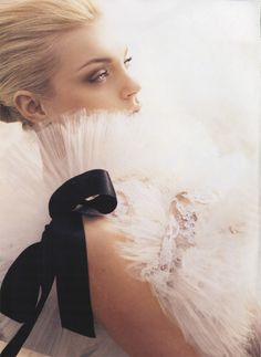 ooh, a tulle ruff or capelet with a big black satin bow would add drama to any ensemble!