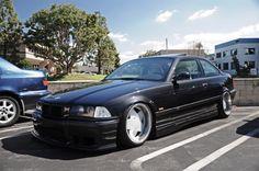 Black BMW e36 coupé on cult classic Borbet A wheels