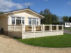 Fensys holiday lodge deck in cream with mixed glass and pickets balustrade hand railing