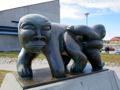 This figure of the orphan Kaassassuk by Greenlandic artist Simon Kristoffersen is outside the Greenland Home Rule Parliament (Inatsisartut) in Nuuk. Garden Sculpture, Lion Sculpture, Tours, Places, Outdoor Decor, Artist, Blog, Photography, Ice