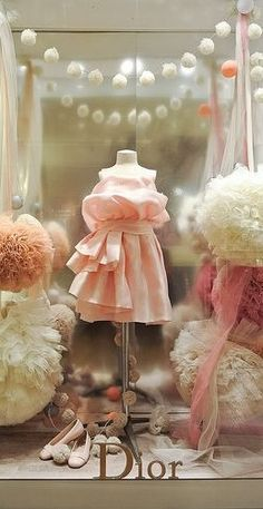 Vitrine Dior, Paris, France - learn how to make tulle poms for your store window here: http://www.nashvillewrapscommunity.com/blog/2012/08/learn-how-to-make-fun-easy-tulle-poms/