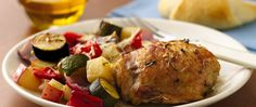 Exotic but irresistible, this chicken dish is scented with rosemary and garlic, with meat roasting alongside zucchini, potatoes, and other veggies.