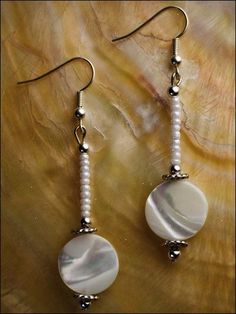 White is essential and goes with everything. Beautiful coin shell beads are stunning with a dash of small beads and shining silver. This e-pattern was originally published in Earrings Earrings Earrings! Size: 2 1\/2\ long. Skill Level: Easy