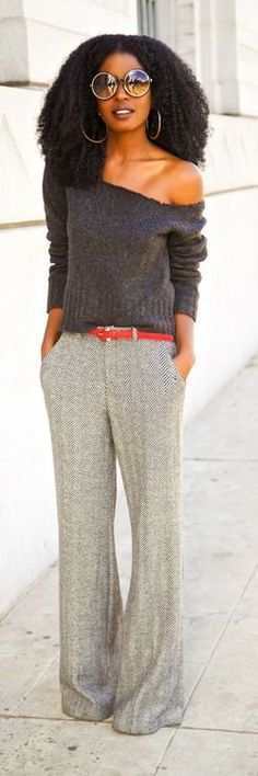 Deep grey sweater and pale grey pants with tiny red belt.