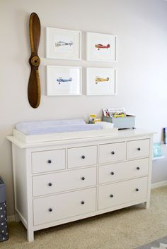 The fabulous thing about decorating the nursery - it doesn't have to be child-like.  BTW - like the changing table? it's a dresser from IKEA!  |  via projectnursery.com