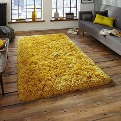 Mustard yellow rug + rough wood floors