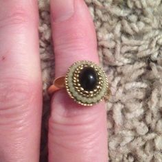 Clearance Classy ring. Vintage 2/12 Black stone yellow metal. Abt size 7 Avon Jewelry Rings