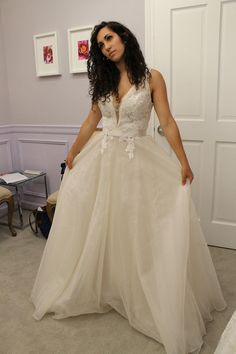 Season 14 Featured Dress: Tara Keely. A-line. Plunging neckline. $2,200.