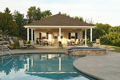 Stamped concrete pool deck: pebble etched concrete with gray color.