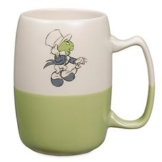 Disney Jiminy Cricket Sketch Mug: You'll hop-to-it each morning when inspired by the jumpin' Jiminy sketch on this vintage-style hot beverage mug with matte finish top and glossy dip glaze base. Disney Coffee Mugs, Cute Coffee Mugs, Coffee Cups, Coffee Time, Disney Classics Collection, Disney Cups, Jiminy Cricket, Disney Kitchen, Disney Traditions