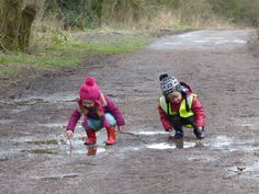 Marvelous Mud- Autumn and Josh stir up the mud with sticks they found earlier (CI)