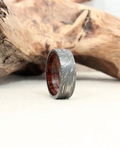 Hey, I found this really awesome Etsy listing at https://www.etsy.com/listing/188405300/damascus-steel-wooden-ring-curly-koa