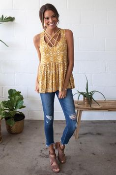 Our Golden State of Mind Tank features cage chest detailing, a mustard aztec print, and a soft peplum.  97% Polyester, 3% Polyurethane Hand Wash Cold, Line Dry  Size and Fit Fit: This garment fits true to size Length: This top measures 25'' from shoulder to hem Model Info Height: 5'9'' Wearing size: Small