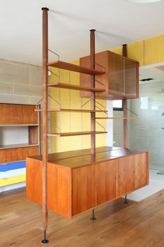 Poul Cadovius Royal System floating wall unit in teak, composed of three vertical ladders, six shelves and six cabinets with sliding doors, multiple shelves and compartments inside. Designed by Poul Cadovius for Royal System design.