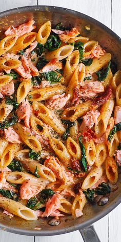 Salmon Pasta with Sun-Dried Tomato Cream Sauce and Spinach - quick and easy dinner made in 30 minutes! Pan-seared salmon is combined with the delicious penne in a flavorful, restaurant-quality cream sauce. Salmon is a Salmon Pasta Recipes, Creamy Salmon Pasta, Salmon And Shrimp, Fish Recipes, Seafood Recipes, Vegetarian Recipes, Chicken Recipes, Dinner Recipes, Healthy Recipes