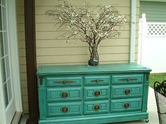 A painted dresser outside?  Perfect for storing outdoor candles, beach towels, sun screen...  I love it!