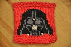 Darth Vader chart suitable for any stranded project. The chart is knit in black and dark grey in addition to the background colour, and a few stitches in light grey are added in duplicate stitch afterwards. The photographed sample was knit in Knit Picks Wool of the Andes worsted weight.