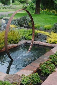 Wine barrel hoop and copper pipe water feature