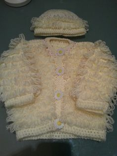 Newborn baby girls crochet loopy jacket and hat set .