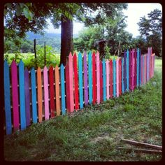 Painted pallets turned into a picket fence for my pig pen!