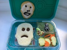 It's a skeletal lunch!  PBNutella skull sandwich, green applesauce with sugar skeleton girl, skull-shaped cucumbers and carrots, two creepy gummies, homemade skull cookie  :)